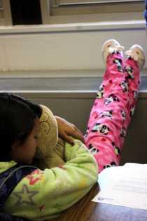 Christina Rucinski (11) takes a short nap with her pillow pet after the PSAT.