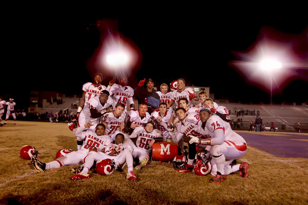 The seniors pose with the barrel after the game.