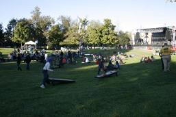 Students play corn-hole as one of the many activities at the festival. . Photo by Sarah Rohleder.