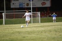 Melissa Kapsalis (11) kicks the ball down the field towards goal.