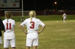 Allison Whitfield (9) watches as her teammate takes a penalty kick to win the game.