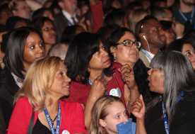 Obama supporters look at TV screens in dissapointment as Mitt Romney gets ahead in the polls.