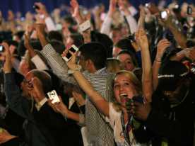 """Obama supporters cheer and chant """"four more years"""" when Obama rises in the polls."""