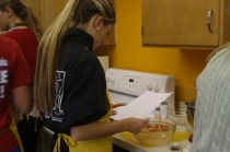 Skylar Herman (12) reads directions to prepare the perfect recipe. Photo by Destony Curry
