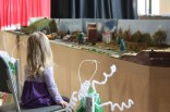 A little girl is captivated by the model train. Photo by Molly Loehr