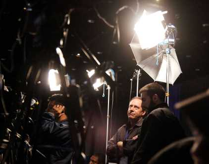 Reporters from national and international news organizations fight to secure a spot in the media section to set up lighting and camera equipment in several hours before guests of the Obama rally arrive.
