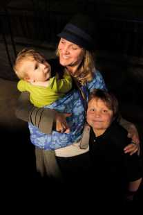"""""""Prayer. That is how I have supported Obama,"""" said Vicki Lidstrom, mother of Vaughn (left) propped on her hip and Arlo (right) hugged under her shoulder, moments before they enter the crowd of thousands to witness President Obama's first address to the nation as a second term president. Vickie said, """"I wanted to show my 7 year old what politics are all about. This night is exciting and pivital for them."""" """"I get to meet the president!"""" Arlo jumped around, singing excitedly."""