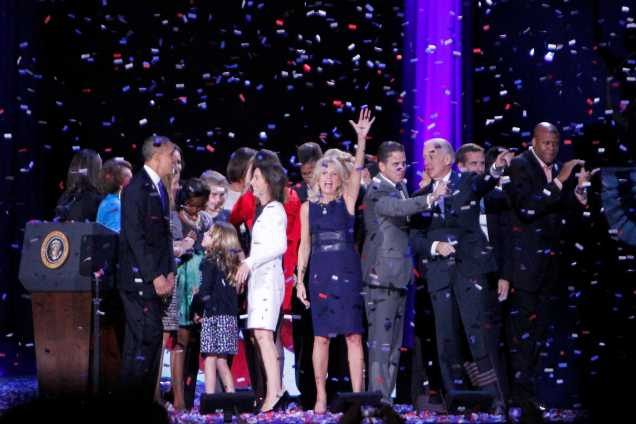 After an explosion of confetti fills the eccentric air in McCormick Place directly following President Obama's address to the nation, family of President Obama and Vice President Joe Biden share the stage in celebration with the majority of Americans during the last moments of the Obama rally and the 2012 election night.