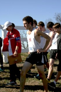 Jacob Shpilberg (12) paces next to coach Debra Moore after the race.