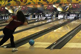 Delayna Shulak (12) adds spin to her ball before it reaches the lane.