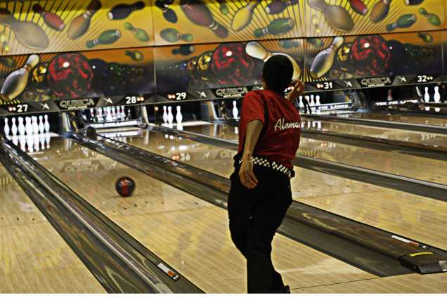 Immanual Aleman (9) send the ball down the lane for a strike.