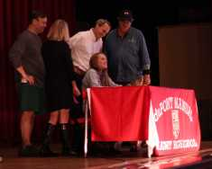 Ellie Grimes, (12) signs her letter of intent to swim at the University of Pennsylvania.