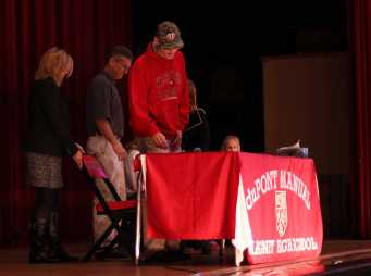Harrison Scanlon, (12) stands after signing his letter of intent to play baseball at Western Kentucky University.