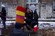 VA freshmen have a laugh while attaching a large piece into the tree bark in the middle of the courtyard. Photo by Noelle Pouzar.