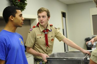 Curtis Lipsey(11) and Bryan Croft(11) of Atherton high school set up serving tables early in the evening. Photo by Jack Steele Mattingly