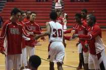 Dwayne Sutton (10, #30) joins his teammates in the starting lineup just before the start of the game.