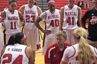 Stacy Pendleton (Coach) refreshes the Lady Crimsons on their game plan during a time out