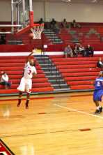 Erika Hawkins (11, #3) makes a lay-up after a fast break leaves her with no defenders