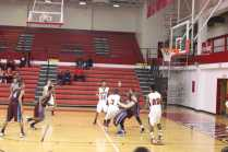 Mike Nero (10, #3) draws a charge on the opposing Jeffersontown Charger in his way