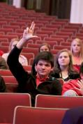 Evan Oberhausen (12) cheers on his classmates.