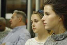 Sadie Birchfield (12) and Hannah Oliver (12) watch their peers read their pieces