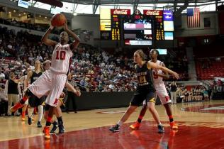 Kayla Styles (#10, 12) goes up for 2 points in the closing minutes of the game.