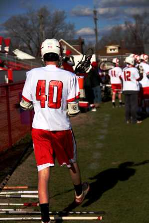 #40 (John-Ross Gribbins) walks towards his team to watch from the sidelines.
