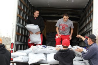 Parents also help load the trucks with mulch.