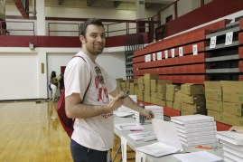 Bo James (faculty) came to pick up his yearbook early, but had difficulties due to his name not being on the list. Photo by Mai Nguyen.
