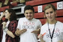 Jack Mattingly (11) showed off his yearbook staff t-shirt enthusiastically while his fellow yearbookers resumed their work. Photo by Mai Nguyen.