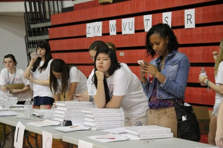 Yearbook staffers waited for rush of students to pick up their yearbook. Photo by Mai Nguyen.