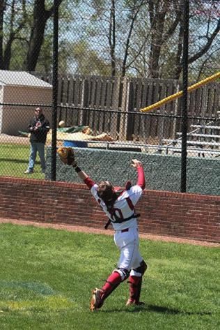 Ben Hachten (12) tries to catch a foul ball.