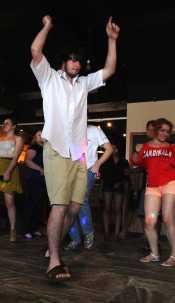 Chase Grimes(11), dances on dance floor with other students.