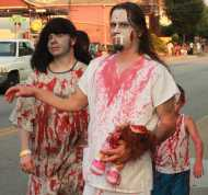 Hungry zombies walk slowly down Bardstown Road in search for brains.