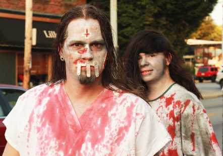 Giving the stare of death to passerbys, zombies continue down Bardstown Road.