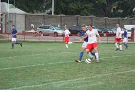 Sam Ross (12, #11) uses a spin move to keep possession and work his way past the CAL defender