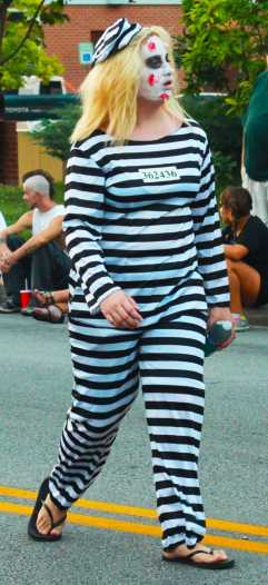 Fresh out of jail, zombie makes its way down Bardstown road for Zombie festivities.