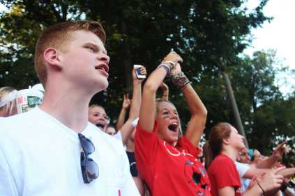 Dalen Jones (11) and Samantha Melton (11) cheer on Manual's varsity team.