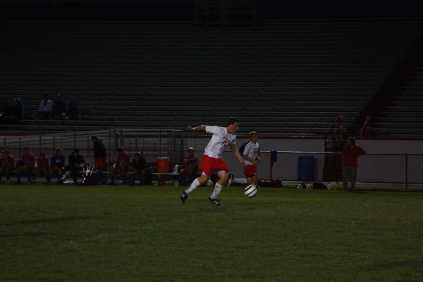 Sam Ross (12, #11) moves the ball on a transition into the offensive zone