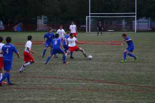Sam Ross (12, #11) steals e ball from a failed attempt by CAL to clear the ball