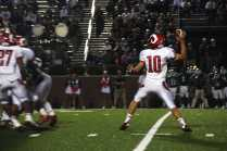 Mason Motley (12 #10) throws towards another Manual player as he is almost sacked.