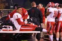 The coaches brought Ryan West (12, #1) off the field after injuring his ankle.