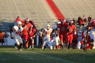 Crimson defense chases down the ball. Photo by Emma Bornschein.