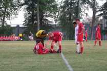 Nick Zehnder (#10,12) helps Ryan Tarr (#20, 12) after Tarr gets kicked in face by Male player. Photo by Cicada Hoyt.