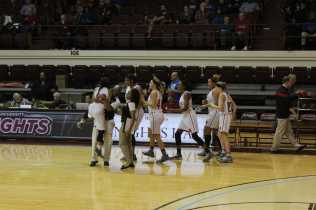Tyonne Howard (12, #12) celebrates with her team after hitting the game winning shot against GRC. Photo by Cicada Hoyt.