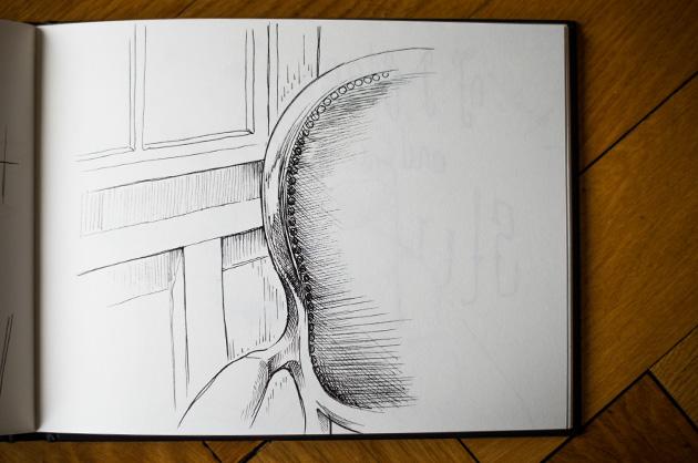 Handskizze von einem Sessel, Detail von Arm- und Rückenlehne