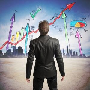 Businessman watchs successful statistics of a company