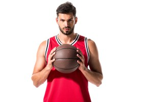 basketball player wearing red jersey and holding a basketball