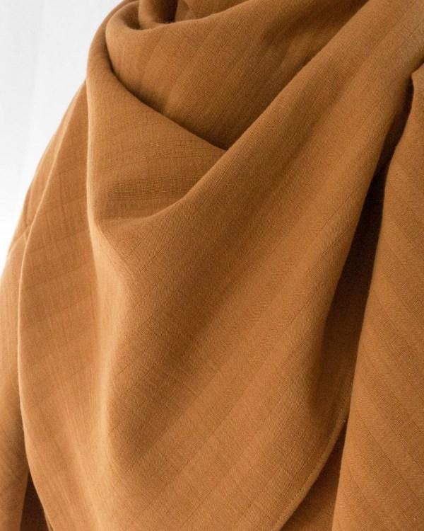 Nachhaltiges XXL Bio Baumwolltuch Musselin Ocker Gelb Senf Manufaktur Nicola Marisa 4 <ul> <li>100% Bio-Baumwolle</li> <li>Handmade in Germany</li> </ul>