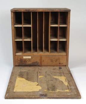 When opened the desk provided a flat writing surface and pigeonholes for various forms and paperwork. CHS 1993.164.0